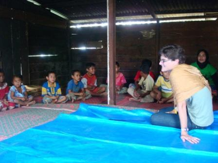 Vice President of Global Programs Anne Scott visits with children in Indonesia last week.