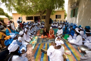 A group of grandmothers in Senegal gather as part of the community-mobilization effort to prevent malaria. Photo: (c) Catherine Karnow/Malaria No More