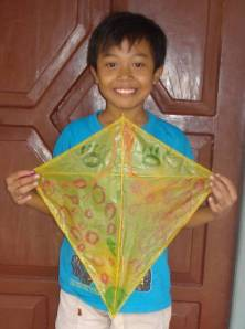 Ardyan, from Indonesia, is all smiles with the kite he made.