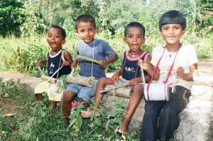 Kolitha (in the light blue) and his friends sing songs and beat their drums in Sri Lanka.