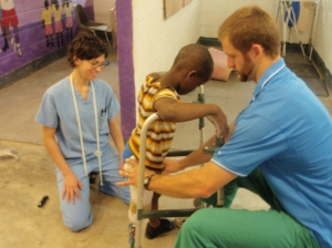 Fitting a Haitan boy with prosthetics