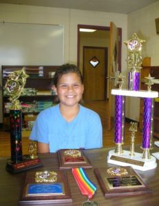 photo of Katie with awards