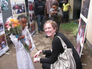 Photo of young girl presenting flowers to Sarah Bouchie