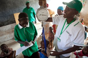 ChildFund staff check children's weight