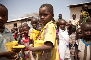 Photo of Kenya children with cups awaiting food