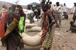 Women carying sacks of maize