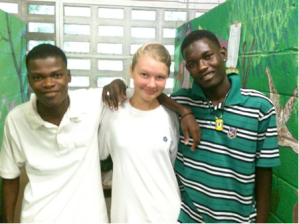Two boys with girl volunteer