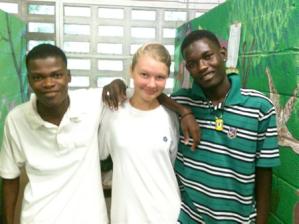 Two boys with girl volunteer