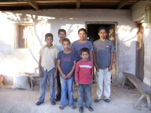 Honduran family in front of house