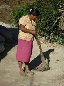 woman sweeping