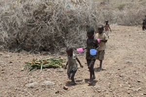 Malnourished children walking in desert