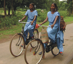 Two girls on bicycles