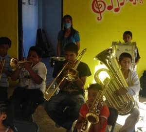 boy in music ensemble
