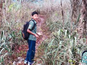 Estu walks to school