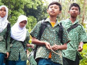 boy with friends walking to school