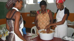 Young women learn to cook