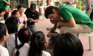 David Archuleta talks with children