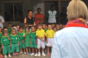 children singing for guest