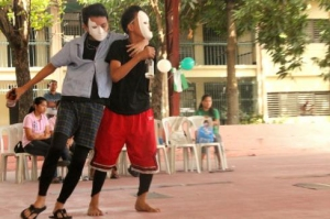 Two boys perform in skit