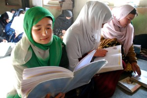 Afghan girls studying