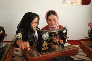Girls learning to sew