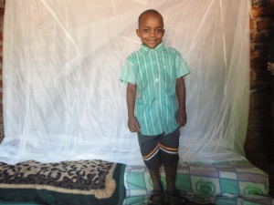 boy with mosquito net