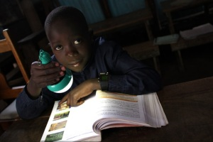Boy studying by solar light
