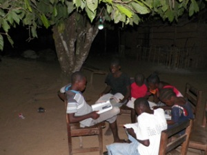 Youth studying by solar light