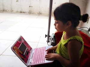 girl with toy computer