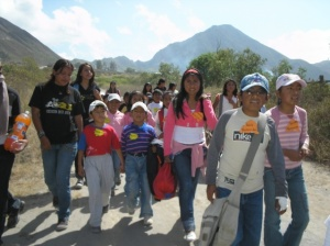 children and youth walk outside