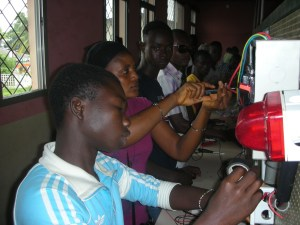 youth repairing electronics