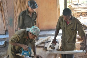 Young men using carpentry tools