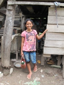 young girl in front of house