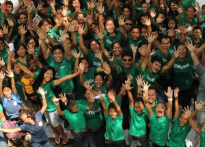 Staff, volunteers and children from ChildFund program in the Southern Philippines in ChildFund green.