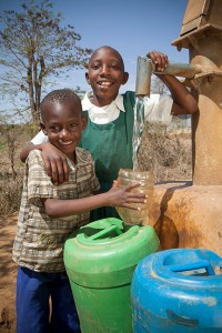 two children at well