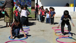 children playing with hoops on ground