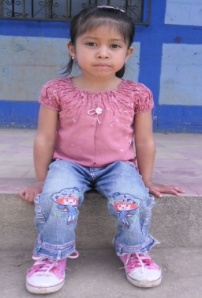 little girl wearing jeans