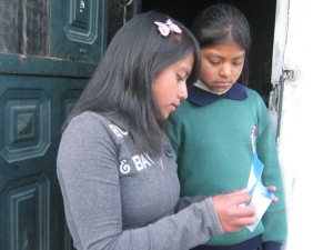 two girls with letter