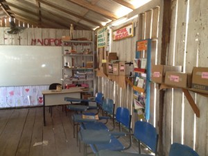 Amazon village classroom with sparse furnishings.