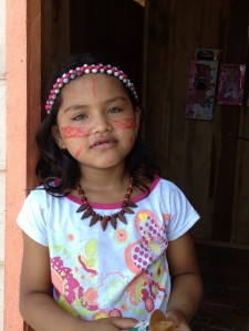 Girl from Amazin village with traditional painted face.