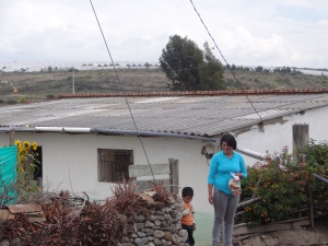 Boy and mother outside their house