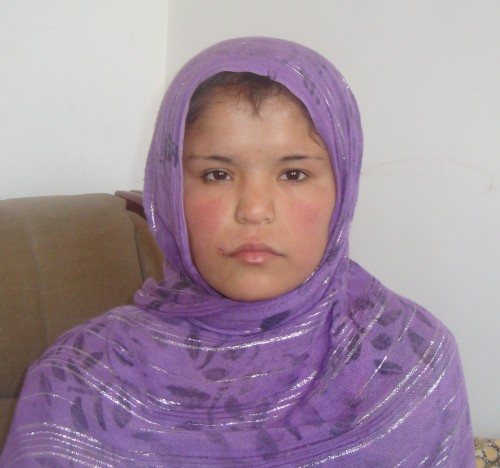 Afghan girl in purple dress