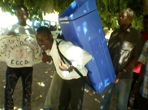 man carrying water filter on his back