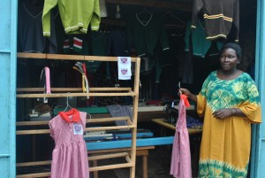 womand displays clothing at shop
