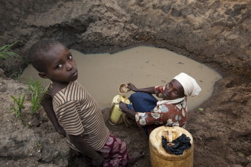 Children like Rachel, 8, collect water for drinking and cooking from unsafe sources like sandy wells and muddy streams.