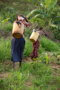 Rachel and her mother, Patricia, return home after collecting water.