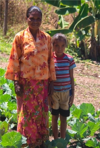 mother and child in a Timor-Leste garden