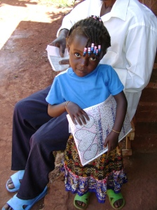 Ugandan girl holds memory book