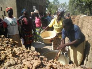 women cooking grain