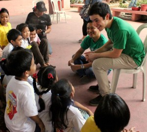 Performer David Archuleta talks with children in Philippines.